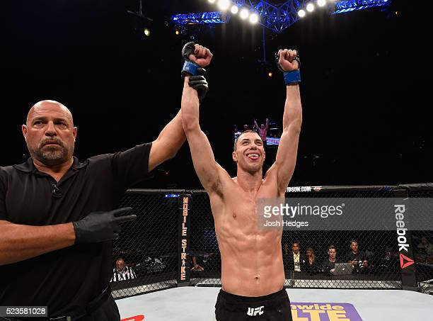 James Vick celebrates his decision victory over Glaico Franca of Brazil in their lightweight bout during the UFC 197 event inside MGM Grand Garden...