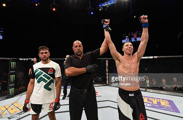 James Vick celebrates his victory over Glaico Franca of Brazil decision in their lightweight bout during the UFC 197 event inside MGM Grand Garden...
