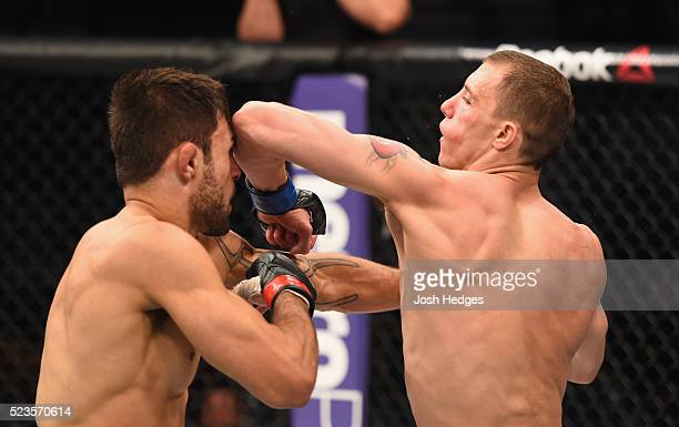 James Vick elbows Glaico Franca of Brazil in their lightweight bout during the UFC 197 event inside MGM Grand Garden Arena on April 23 2016 in Las...