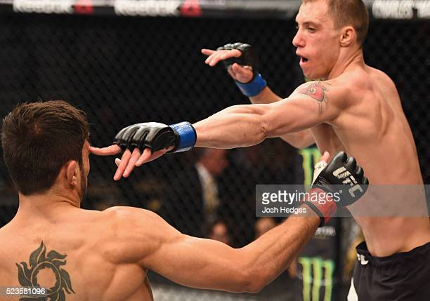 James Vick exchanges punches with Glaico Franca in their lightweight bout during the UFC 197 event inside MGM Grand Garden Arena on April 23 2016 in...