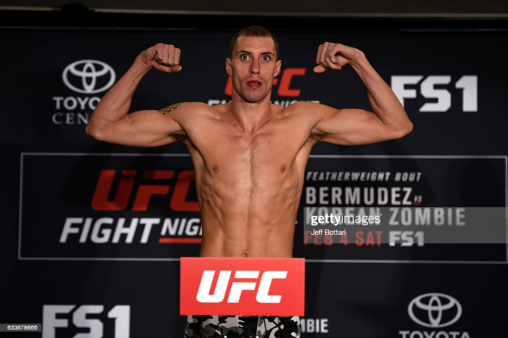 James Vick poses on the scale during the UFC Fight Night weigh-in at the Sheraton North Houston at George Bush Intercontinental on February 3, 2017 in Houston, Texas.
