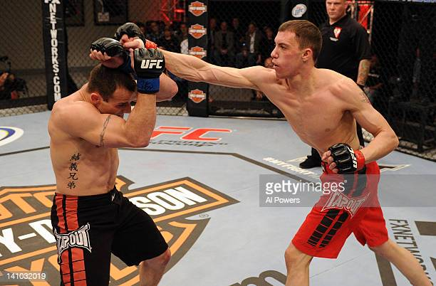 James Vick punches Dakota Cochrane during the first episode of The Ultimate Fighter Live at the Ultimate Fighter Gym on March 9 2012 in Las Vegas...