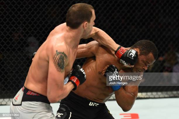 James Vick punches Francisco Trinaldo of Brazil in their lightweight bout during the UFC Fight Night event at Frank Erwin Center on February 18 2018...