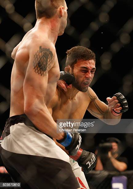 James Vick punches Glaico Franca in their lightweight bout during the UFC 197 event inside MGM Grand Garden Arena on April 23 2016 in Las Vegas Nevada