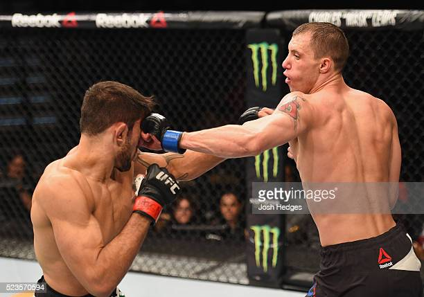 James Vick punches Glaico Franca of Brazil in their lightweight bout during the UFC 197 event inside MGM Grand Garden Arena on April 23 2016 in Las...