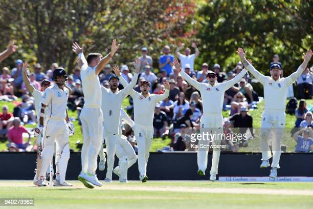 James Vince Dawid Malan Joe Root and Ben Stokes of England celebrate after James Anderson of England dismisses Jeet Raval of New Zealand during day...