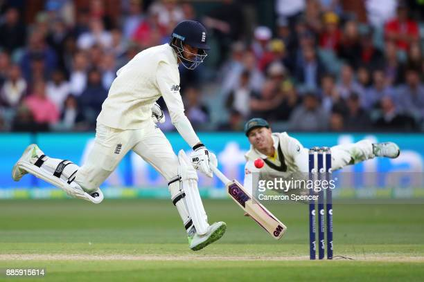 James Vince of England avoids a runout attempt by David Warner of Australia during day four of the Second Test match during the 2017/18 Ashes Series...