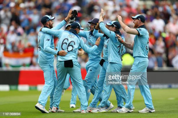 James Vince of England celebrates with his team mates after catching the wicket of Alex Carey of Australia on the boundary during the SemiFinal match...