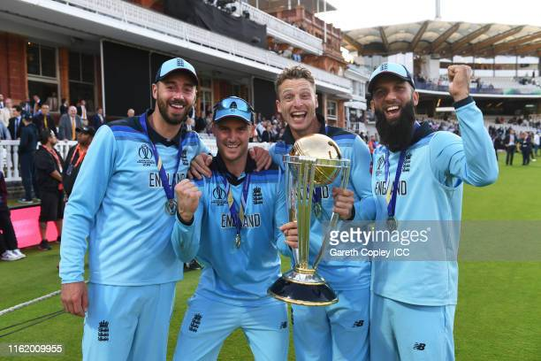 James Vince of England, Jason Roy of England, Jos Buttler of England and Moeen Ali of England celebrate after winning the Cricket World Cup during...