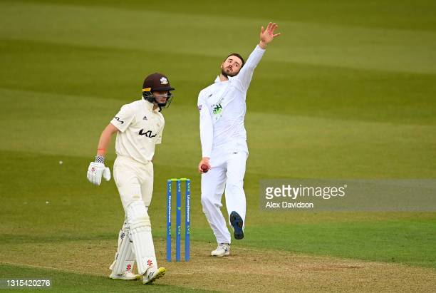 James Vince of Hampshire bowls watched on by Ollie Pope of Surrey during Day Two of the LV= Insurance County Championship match between Surrey and...