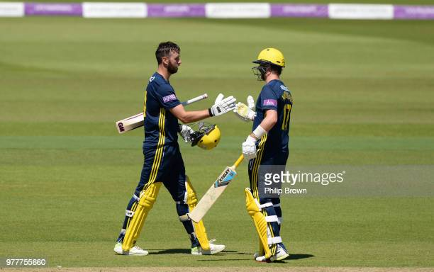 James Vince of Hampshire celebrates with Sam Northeast after Vince reached his century during the Royal London OneDay Cup SemiFinal match between...