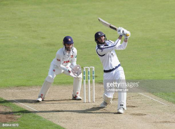 James Vince of Hampshire in action as wicket keeper James Foster looks on during the Specsavers County Championship Division One match between...