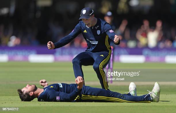 James Vince of Hampshire lies flat on his back after taking a catch to dismiss Joe Denly of Kent as teammate Tom Alsop runs to congratulate him...