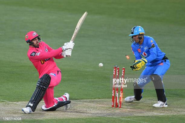 James Vince of the Sixers is bowled by Rashid Khan of the Strikers during the Big Bash League match between the Sydney Sixers and the Adelaide...