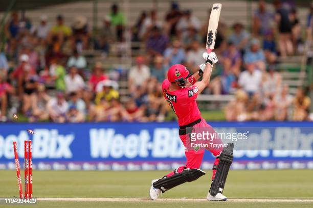 James Vince of the Sydney Sixers is bowled during the Big Bash League match between the Hobart Hurricanes and the Sydney Sixers at Traeger Park on...