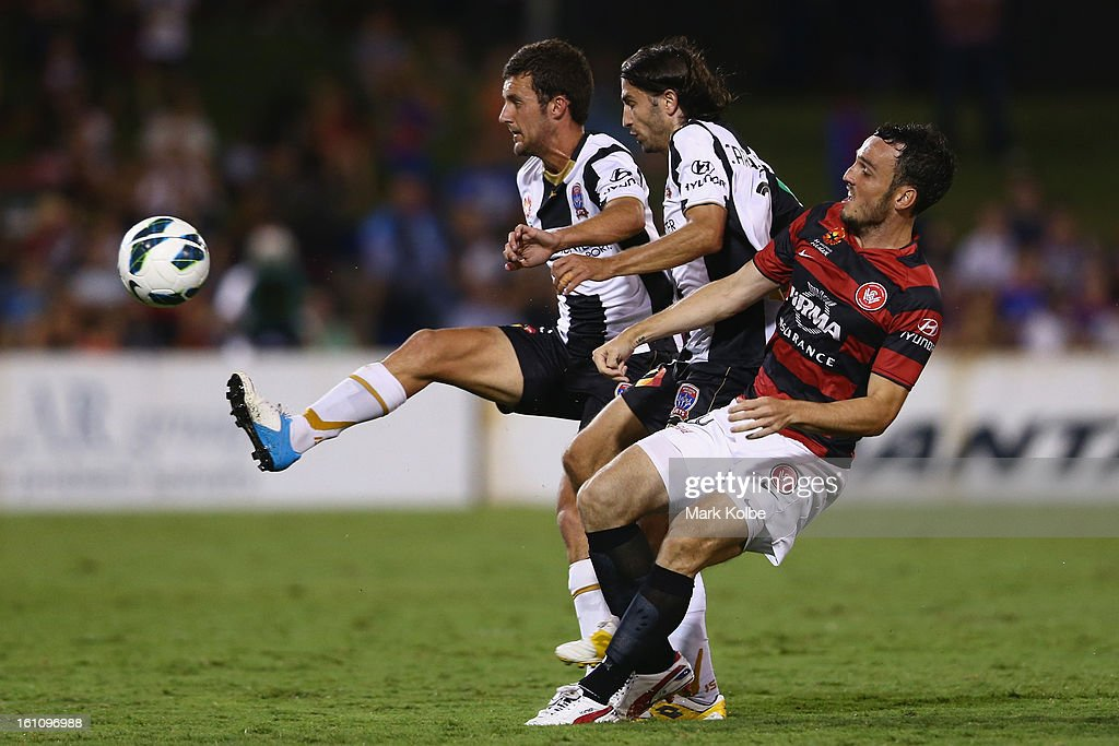 James Virgili and Zenon Caravella of the Jets and Mark Bridge of the Wanderers compete for the ball during the round 20 A-League match between the Western Sydney Wanderers and the Newcastle Jets at Campbelltown Sports Stadium on February 9, 2013 in Sydney, Australia.
