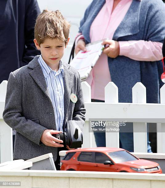 James Viscount Severn drives a radio controlled Land Rover toy car around a model offroad course on day 4 of the Royal Windsor Horse Show in Home...