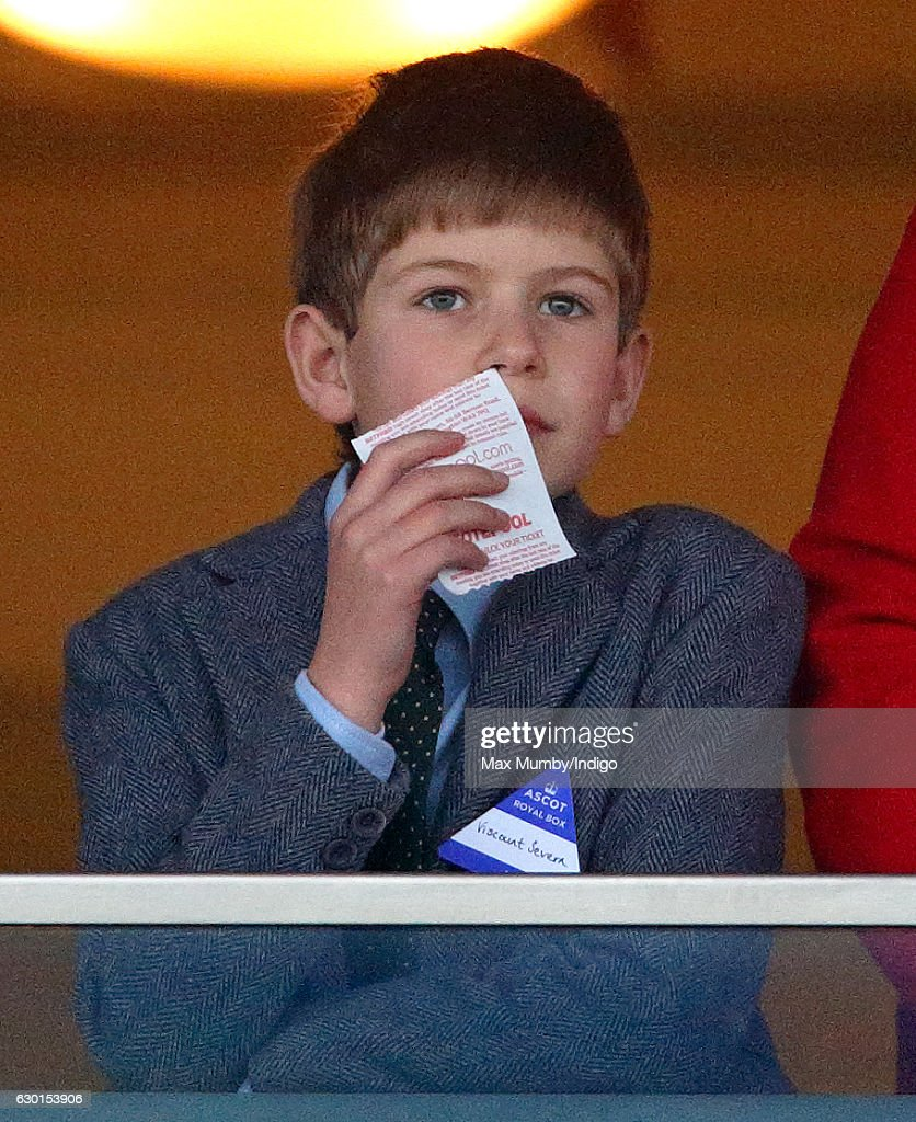 James, Viscount Severn (who celebrates his 9th birthday today) holds a betting slip whilst watching the racing during the Christmas Racing Meet at Ascot Racecourse on December 17, 2016 in Ascot, England.