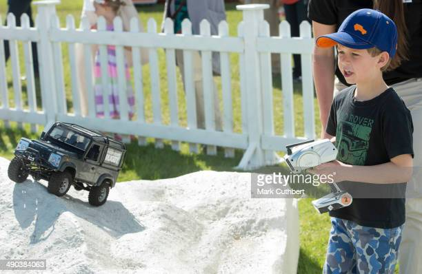 James Viscount Severn plays on the remote control Land Rover stand at the Royal Windsor Horse Show at Home Park on May 14 2014 in Windsor England