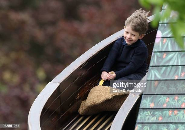James Viscount Severn son of Prince Edward Earl of Wessex and Sophie Countess of Wessex slides down the fun fair helter skelter on day 4 of the Royal...