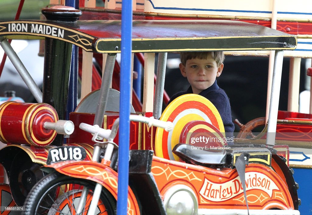James, Viscount Severn (L), son of Prince Edward, Earl of Wessex, and Sophie, Countess of Wessex, rides on the fun fair carousel on day 4 of the Royal Windsor Horse Show on May 11, 2013 in Windsor, England.