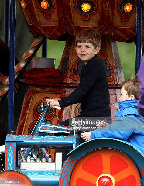 James Viscount Severn son of Prince Edward Earl of Wessex and Sophie Countess of Wessex rides on the fun fair carousel on day 4 of the Royal Windsor...
