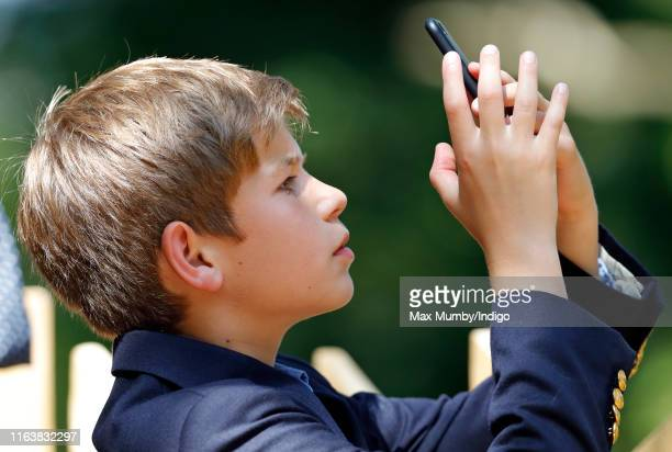 James, Viscount Severn takes photographs on his mobile phone as he visits The Wild Place Project at Bristol Zoo on July 23, 2019 in Bristol, England.