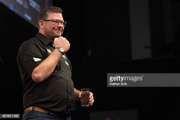 James Wade of England celebrates after winning the semifinal match against Gary Anderson of Scotland during the SINGHA Beer Grand Slam of Darts at...