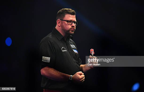 James Wade of England celebrates during his first round match against Ronny Huybrechts of Belgium on day seven of the 2017 William Hill PDC World...