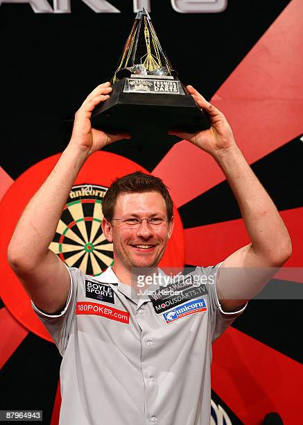 James Wade of England celebrates with the trophy after defeating Mervyn King of England during The Final of The Whyte Mackay Premier League Darts...