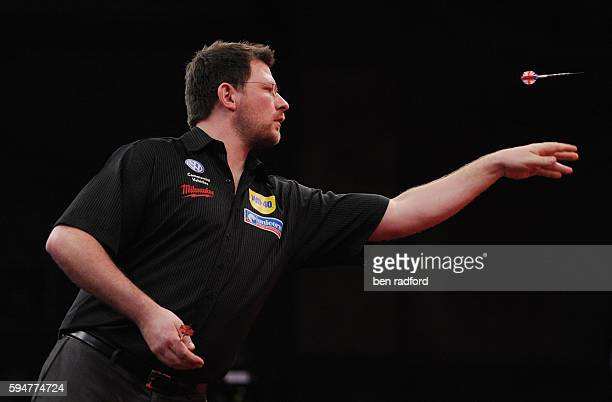 James Wade of England during his second round match against Mensur Suljovic of Austria at the PDC World Darts Championships at Alexandra Palace in...