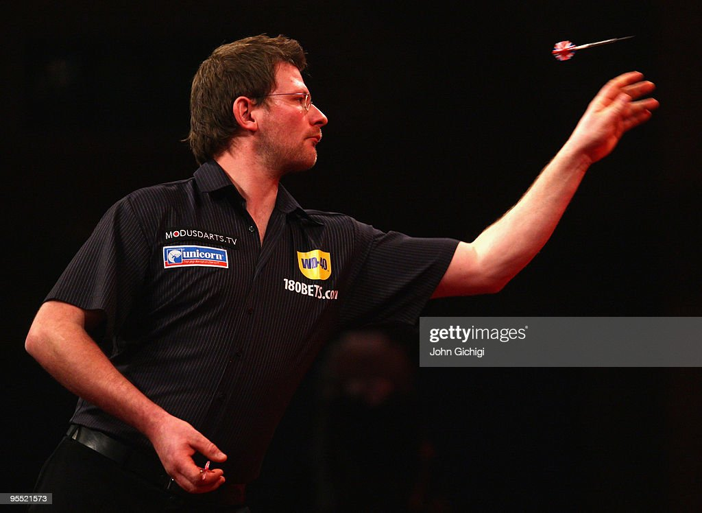 James Wade of England in action against Simon Whitlock of Australia during the Quarter Finals of the 2010 Ladbrokes.com World Darts Championships at Alexandra Palace on January 1, 2010 in London, England.