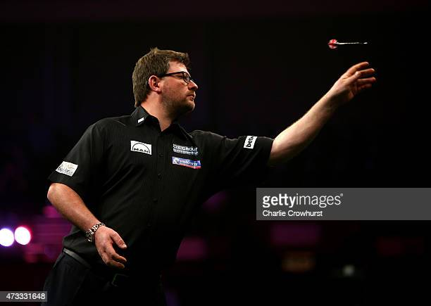 James Wade of England in action during his match against Phil Taylor of England during the Betway Premier League at The Brighton Centre on May 14...