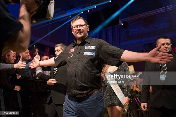 James Wade of England is greeted by the crowd ahead of his final game against Michael van Gerwen of the Netherlands during the SINGHA Beer Grand Slam...