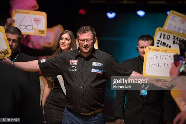 James Wade of England is greeted by the crowd ahead of his game against Gary Anderson of Scotland during the SINGHA Beer Grand Slam of Darts at...