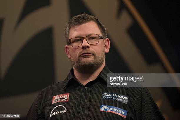 James Wade of England looks on during his final match against Michael van Gerwen of the Netherlands during the SINGHA Beer Grand Slam of Darts at...