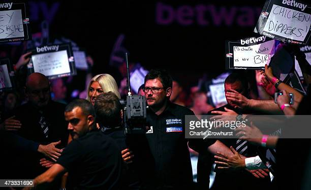 James Wade of England makes his entrance during his match against Phil Taylor of England during the Betway Premier League at The Brighton Centre on...