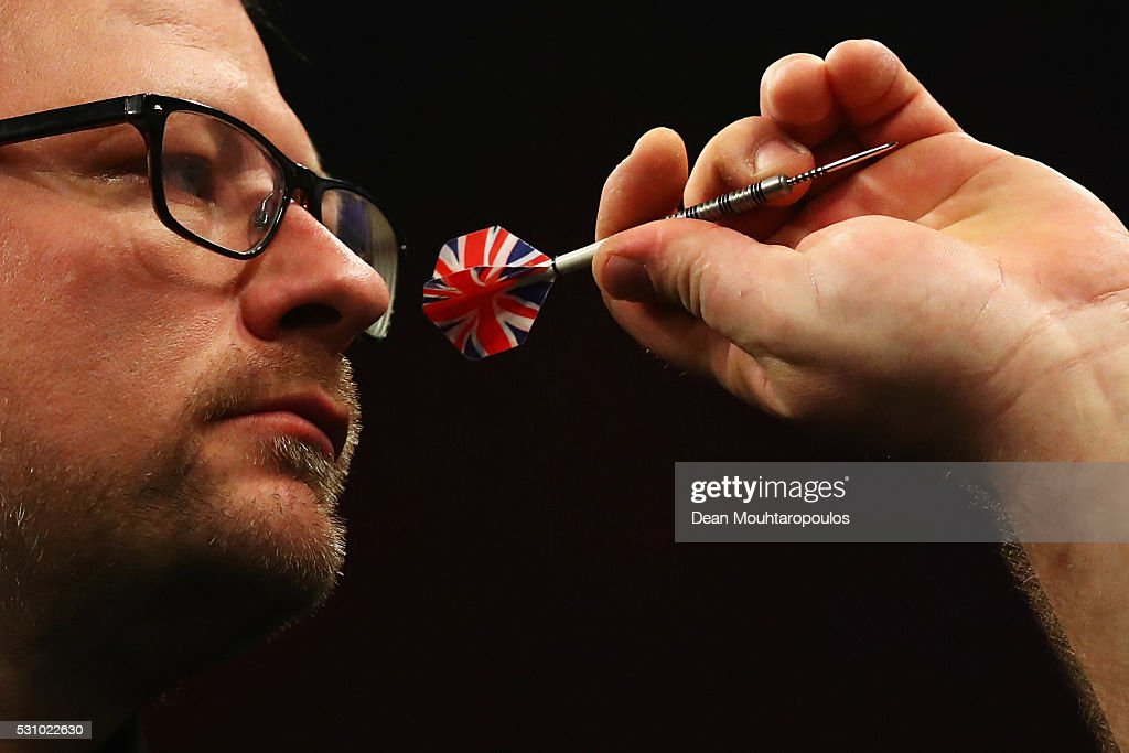James Wade of England plays a shot in his match against Robert Thornton of Scotland during the Darts Betway Premier League Night 15 at Rotterdam Ahoy on May 12, 2016 in Rotterdam, .