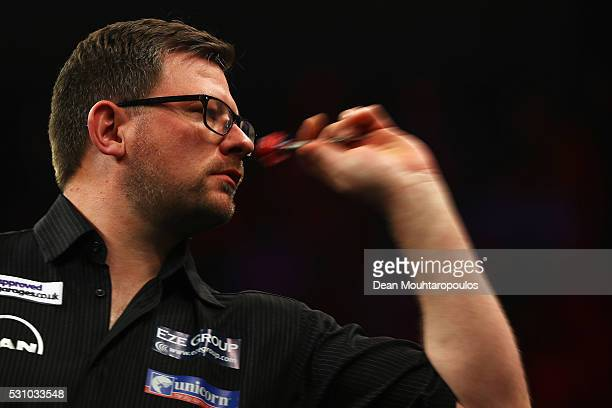 James Wade of England plays a shot in his match against Robert Thornton of Scotland during the Darts Betway Premier League Night 15 at Rotterdam Ahoy...