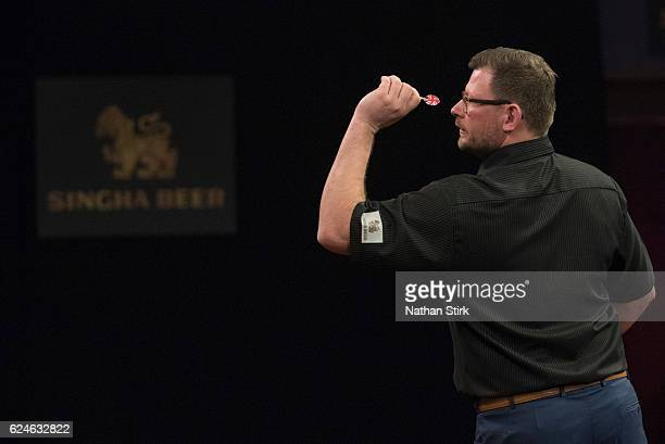James Wade of England plays a shot in his semifinal match against Gary Anderson of Scotland during the SINGHA Beer Grand Slam of Darts at...