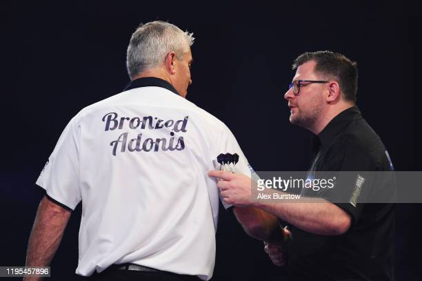 James Wade of England shakes hands with Steve Beaton of England after their Third Round match during Day Ten of the 2020 William Hill World Darts...