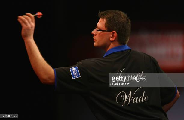 James Wade of England throws a dart during the second round match between James Wade of England and Steve Beaton of England during the 2008...