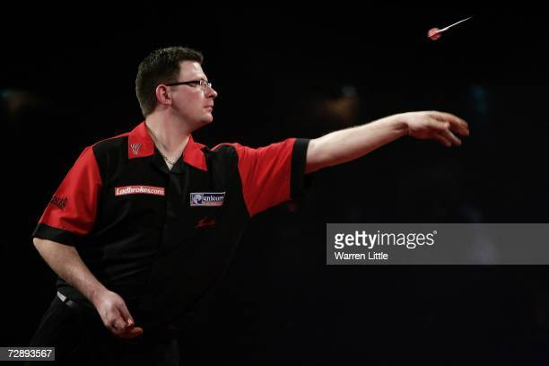 James Wade of England throws against Terry Jenkins of England during the third round match of The Ladbrokes World Darts Championship at The Circus...