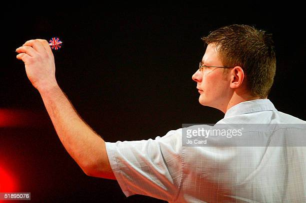 James Wade throws during the 2005 Ladbrokescom World Darts Championship at The Circus Tavern on December 26 2004 in Purfleet England