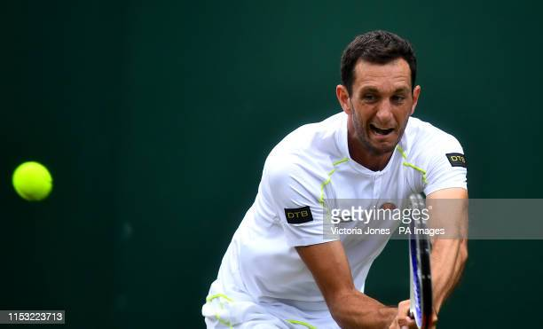 James Ward in action against Nikoloz Basilashvili on day two of the Wimbledon Championships at the All England Lawn Tennis and Croquet Club Wimbledon