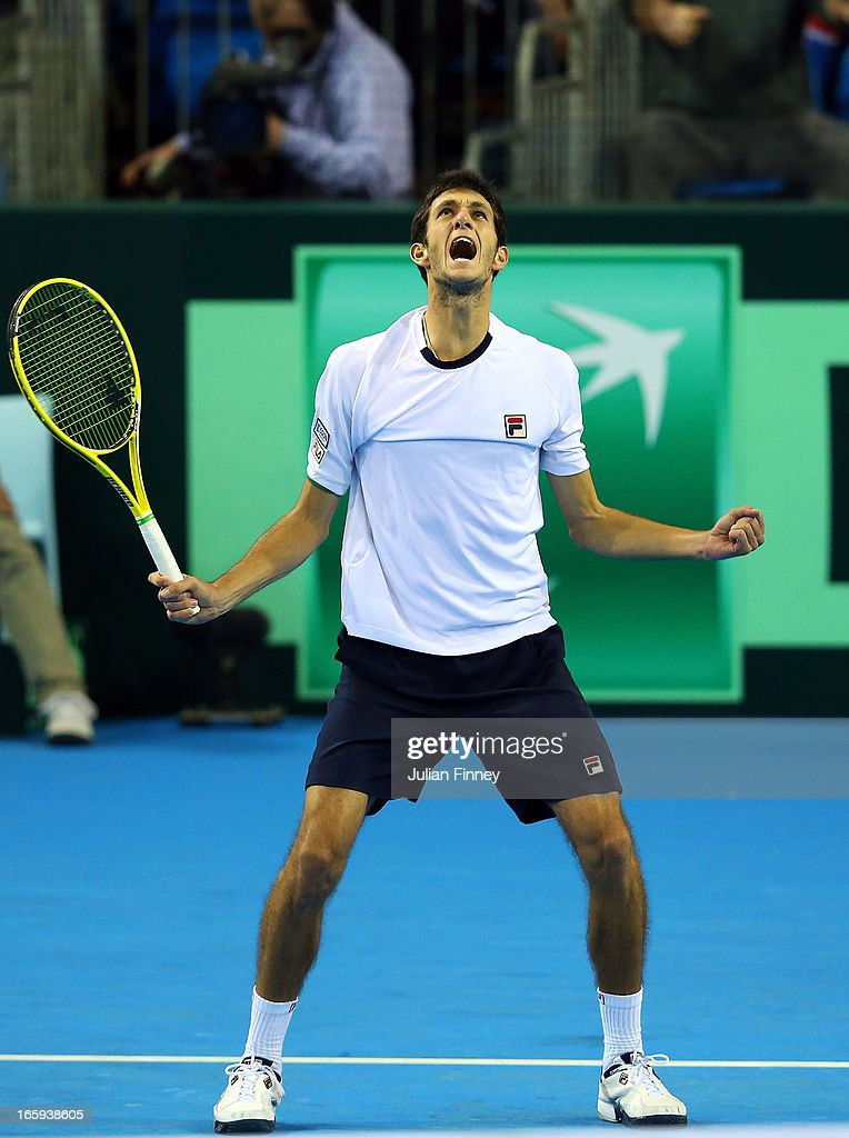 James Ward of Great Britain celebrates at match point in his match against Dmitry Tursunov of Russia during day three of the Davis Cup match between Great Britain and Russia at the Ricoh Arena on April 7, 2013 in Coventry, England.