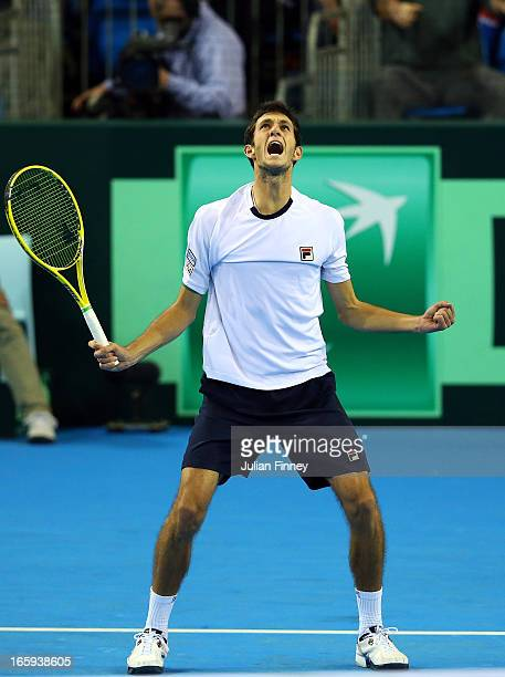 James Ward of Great Britain celebrates at match point in his match against Dmitry Tursunov of Russia during day three of the Davis Cup match between...