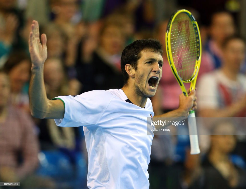 James Ward of Great Britain celebrates winning a point in his match against Dmitry Tursunov of Russia during day three of the Davis Cup match between Great Britain and Russia at the Ricoh Arena on April 7, 2013 in Coventry, England.