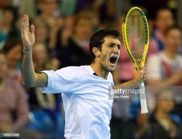 James Ward of Great Britain celebrates winning a point in his match against Dmitry Tursunov of Russia during day three of the Davis Cup match between...