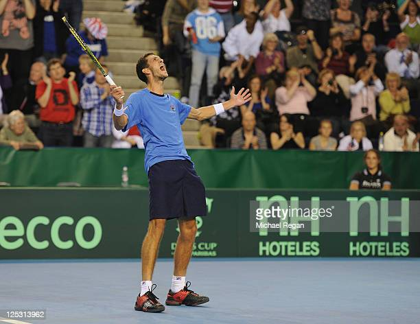 James Ward of Great Britain celebrates winning his match against Attila Balazs on day one of the Davis Cup tie between Great Britain and Hungary at...